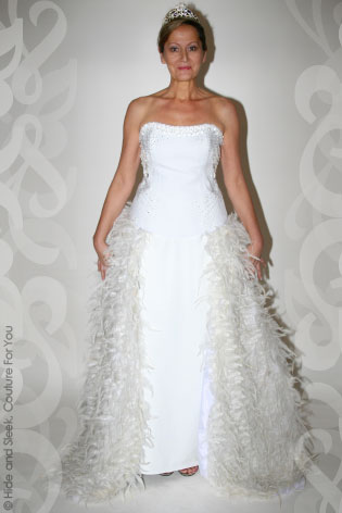 Hide sleek ice bridal gown with feather overskirt for Wedding dress with feathers on bottom